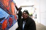 Grupa Haitańczyków w trakcie pracy nad muralem